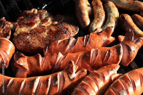 Deurstickers Grill / Barbecue German Bratwurst on Barbecue Grill