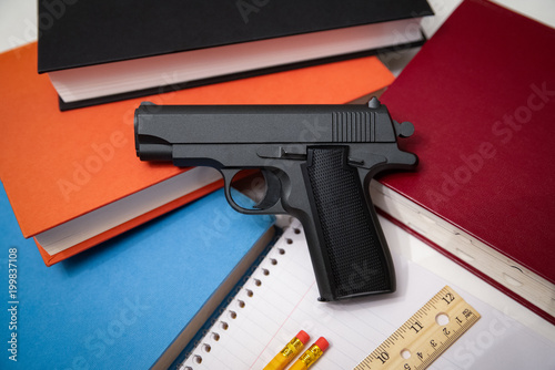 Fotografía  School Supplies and Handgun