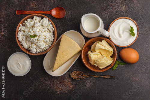 Fotobehang Zuivelproducten Different types of dairy products on dark background, top view, copy space.