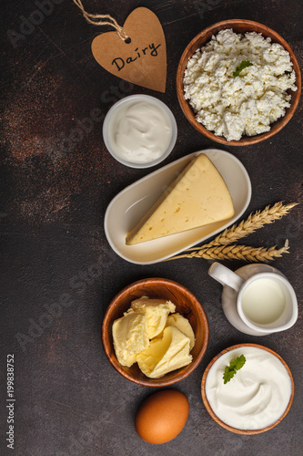 Foto op Plexiglas Zuivelproducten Different types of dairy products on dark background, top view, copy space. Healthy food background.
