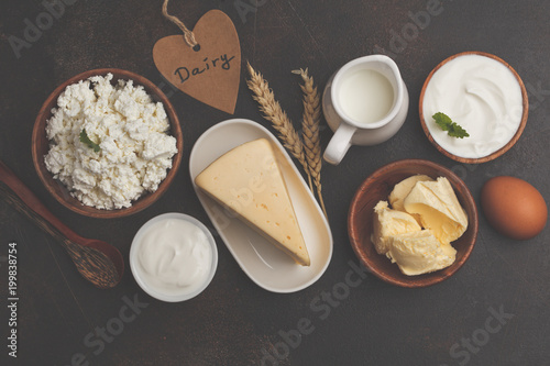 Staande foto Zuivelproducten Different types of dairy products on dark background, top view, copy space. Healthy food background.