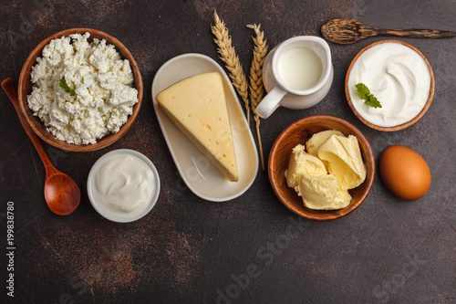 Fotobehang Zuivelproducten Different types of dairy products on dark background, top view, copy space. Healthy food background.