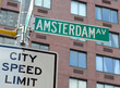 Amsterdam street sign with apartment building background, Manhattan New York