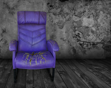 Old Purple Chair In A Dark Room