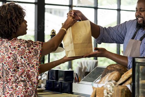 Other Black customer buying bakery products
