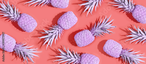Painted pineapples on a vivid pink background