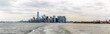 Manhattan Skyline From The Water With Cloudy Skies in Fall Season