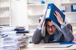 Leinwanddruck Bild - Overloaded with work employee under paperwork burden