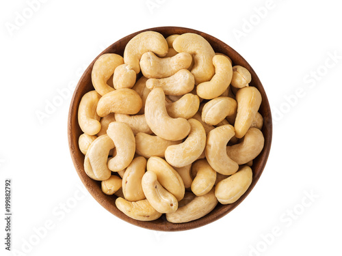 Cashew nut in wooden bowl isolated on white