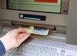 boy withdraws money from an ATM with euro currency