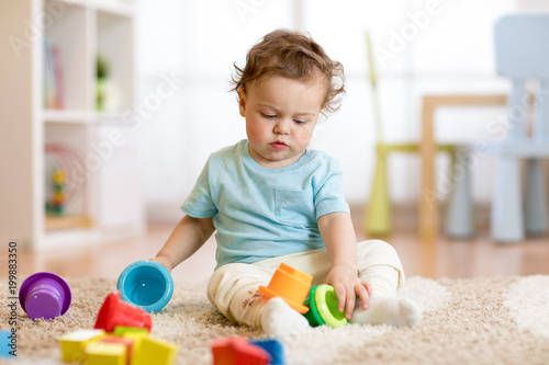 Other baby kid toddler playing toys at home or nursery