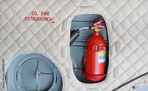 Fire Extinguisher installation in the military airplane.