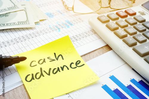Memo stick about cash advance and calculator. Canvas Print