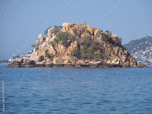 Fotografija  Panorama of rocky island at bay landscape of ACAPULCO city in Mexico, Pacific Oc