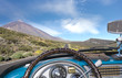view from the inside of a retro cabriolet traveling on a tourist road on Tenerife