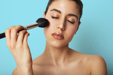 Portrait Of Beautiful Young Woman Doing Her Nude Make-up, Red Lips. Concept Mock Up Photo.