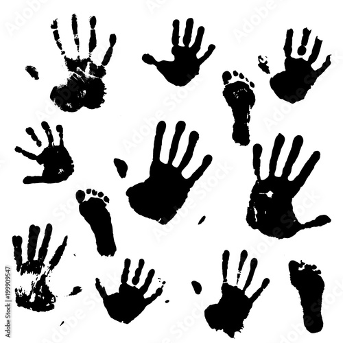 Valokuva  A set of prints of the hands and feet of an adult and a child