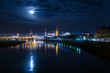 Panorama of the German city Dresden at night with the Elbe and reflecting lights