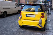 Small Yellow City Car With Arm...