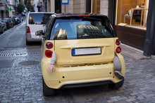 Small Yellow City Car With Bod...