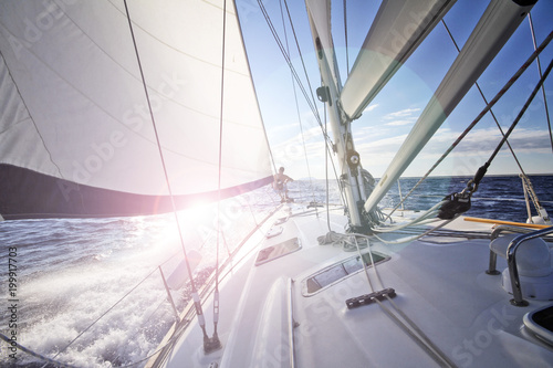 Fotografie, Obraz  Sailing into the sun in Croatia