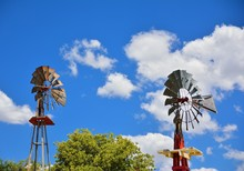 Two Windmill On An Agricultural Farm In USA.
