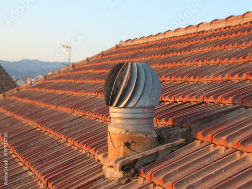 Photo Ventilation Metal Chimney on Shingle Roof with View