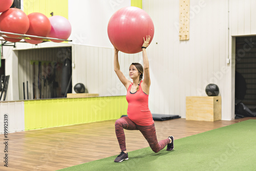 Fotografie, Tablou  Pregnant woman is doing exercises at the gym