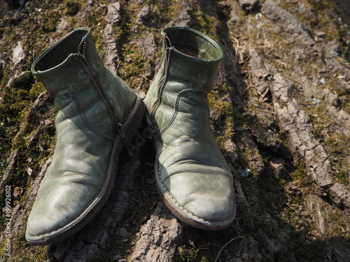 Canvas Prints Countryside Green boots on a tree trunk close up