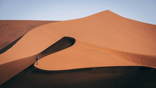 Hiker On Sand Dune