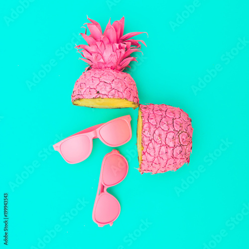 Fényképezés  two painted in pink color halfs of the pineapple of which fall sunglasses