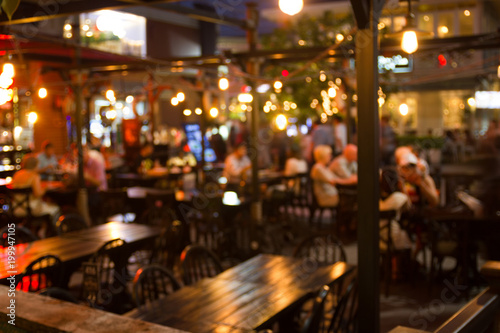 Photo sur Aluminium Restaurant abstract blur image of night festival in a restaurant and The atmosphere is happy and relaxing with bokeh for background, Bangkok Thailand.