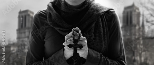 Canvas Print - Christian Religion and hope concept. Woman hands praying with rosary and wooden cross on church background.