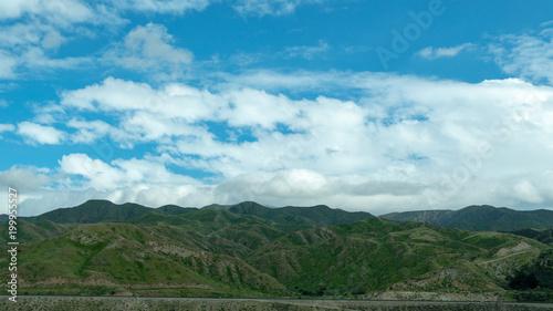 Tuinposter Blauwe jeans Cloudy Landscape