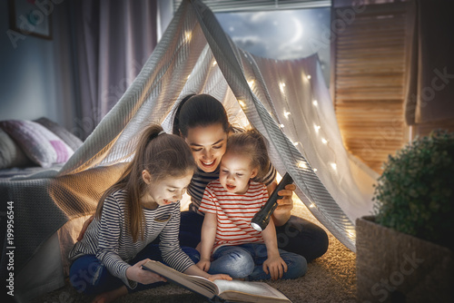 Mom and children reading book