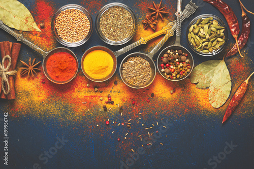 Poster Spices Wooden table of colorful spices