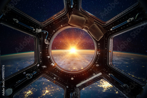 Obraz Earth and galaxy in spaceship international space station window porthole. Elements of this image furnished by NASA - fototapety do salonu
