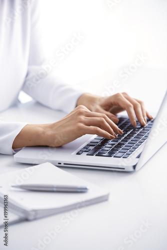 Leinwand Poster Typing on laptop keyboard