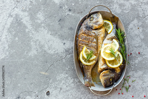Foto auf Leinwand Fisch Baked fish dorado. Sea bream or dorada fish grilled