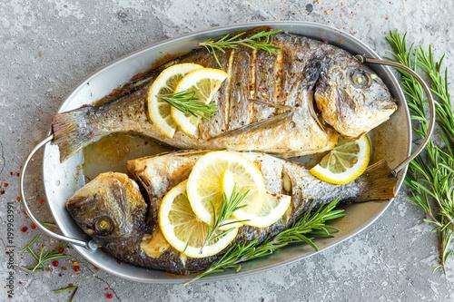 Foto auf Leinwand Fisch Baked fish dorado. Sea bream or dorada fish grilled