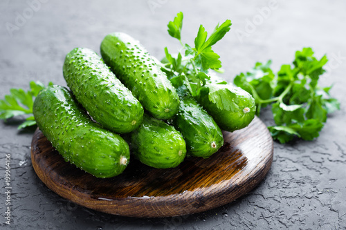 Cucumbers. Fresh cucumbers on wooden board Wallpaper Mural