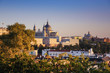 The west wing of Royal Palace of Madrid and Cathedral of Santa María la Real de la Almudena illuminated with sunset view from the north (Debod temple). Madrid, Spain