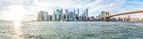 Fototapeta Nowy Jork - Panoramic Panorama view, overlook of outside outdoors in NYC New York City Brooklyn Bridge Park by east river, cityscape skyline during sunset with sun