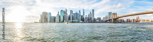 Tuinposter New York Panoramic Panorama view, overlook of outside outdoors in NYC New York City Brooklyn Bridge Park by east river, cityscape skyline during sunset with sun