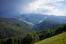 Scenic Green Forested Valley And Cloudscape