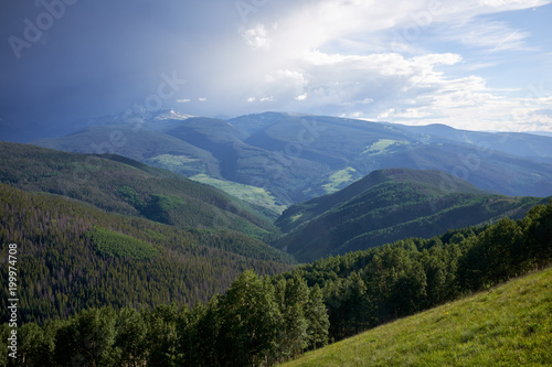 Scenic green forested valley and cloudscape Canvas Print