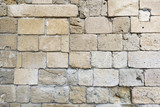 Fototapeta Kamienie - Old stone wall closeup from an ancient medieval castle in Kyrenia, North Cyprus
