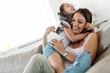 Leinwandbild Motiv Happy family having fun time at home