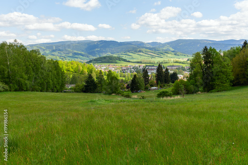 Deurstickers Blauwe hemel Beautiful valley on the mountain. Green meadow.