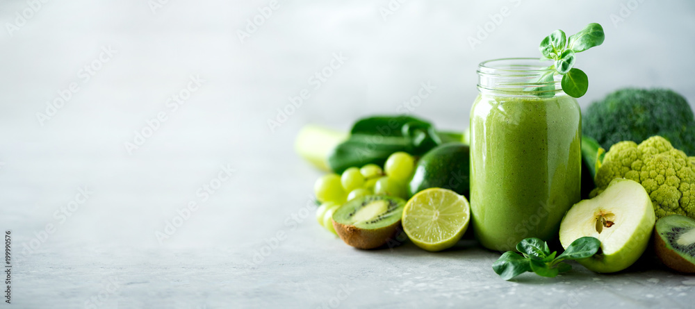 Fototapety, obrazy: Glass jar mugs with green health smoothie, kale leaves, lime, apple, kiwi, grapes, banana, avocado, lettuce. Copy space. Raw, vegan, vegetarian, alkaline food concept. Banner